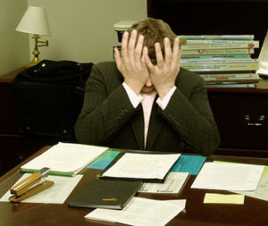 Frustrated man at a desk